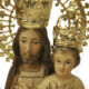 primer plano de las caras de san jose y el niño con las coronas